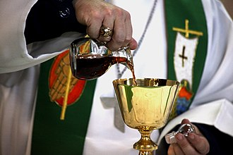 Sacramental wine - Sacramental wine being poured from a cruet into a chalice