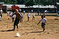 US Navy 110128-M-9683P-274 Seabees assigned to Naval Mobile Construction Battalion (NMCB) 11 play Frisbee with students during a Cobra Gold 2011 co.jpg