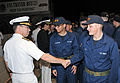 US Navy 110526-N-IK959-763 Rear Adm. David F. Steindl, commander of Naval Service Training Command (NSTC), congratulates a recruit following a capp.jpg