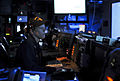 US Navy 110605-N-AQ172-055 Lt. Mary Lowell stands an instruction watch as the tactical action officer in the combat information center aboard the T.jpg
