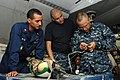 US Navy 110721-N-SP676-172 Aviation Electrician 1st Class Carlos Altig, left, and Aviation Electrician 2nd Class Adam Valverde observe Chief Aviati.jpg