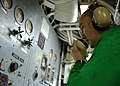 US Navy 110927-N-OE749-002 Aviation Boatswain's Mate (Equipment) 2nd Class Sean Dougherty communicates with flight deck personnel using a sound-pow.jpg