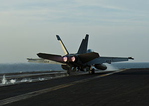 US Navy 120105-N-BT887-732 An F-A-18E Super Hornet from the Tophatters of Strike Fighter Squadron (VFA) 14 launches from the Nimitz-class aircraft.jpg