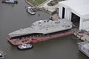 US Navy 120109-O-ZZ999-001 The littoral combat ship Pre-Commissioning Unit (PCU) Coronado (LCS 4) is rolled-out at the Austal USA assembly bay