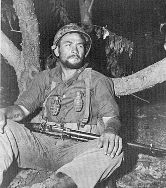 Battle of Masan - An exhausted soldier of the 5th RCT rests after 31 days in combat at Masan.