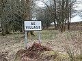 Village of Ae sign, Dumfries & Galloway, Scotland.jpg