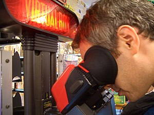 Virtual Boy - A man using a Virtual Boy eyepiece