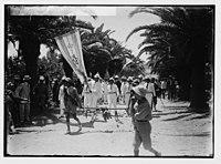 Visiting Jewish colonies. Sir Herbert Samuel preceded by Zionist banner (Richon le Zion). LOC matpc.02297.jpg