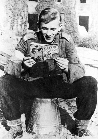"Flash Gordon - A young corporal of the Home Army reading a Polish edition of one of Flash Gordon (""Błysk Gordon"") graphic novels during the Warsaw Uprising of 1944"