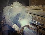 Welder making boilers for a ship 1a35229v.jpg