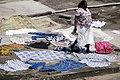 Woman Walks Past Rooftop Laundry - Elmina - Ghana (4721746314).jpg