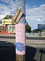 """Yarn bomb - """"That Cafe"""" pole (5520983293).jpg"""
