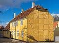 Yellow timber frammed house Roskilde cathedral square Denmark.jpg