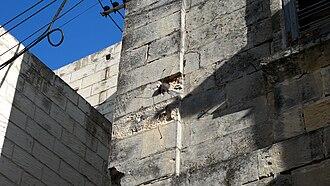Żabbar - Cannonball still lodged in the façade of a house in Żabbar.