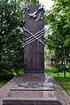 Памятник жертвам политических репрессий во дворе церкви.jpg
