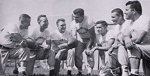 Ara Parseghian - Parseghian (center) and his coaching staff at Northwestern in 1956