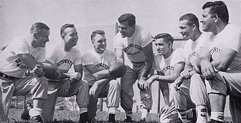 4f20e25f2 Parseghian (center) and his coaching staff at Northwestern in 1956