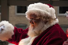 543f326f6427c A man dressed as Santa Claus waves to children from an annual holiday train  in Chicago
