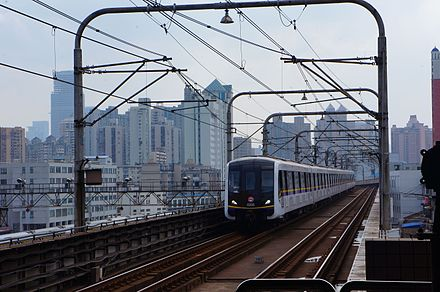 The Shanghai Metro is the world's largest single operator rapid transit system by length, possessing hundreds of kilometers of electrified lines. 201609 0335 leaves from Baoshan Road Station.jpg