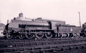 """LSWR N15 class - 30783 Sir Gillemere at Eastleigh, 1950. Note the """"Cycling Lion"""" crest on the eight-wheel bogie tender"""