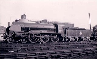 Side profile of a 4-6-0 locomotive on shed.