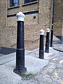 3 Posts At Head Of Steps Leading Down To Provost Street 1.jpg