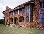 This mansion was designed in 1904 by Sir Herbert Baker. It is constructed of dressed mountain stone and brick and, from a town-planning point of view, forms an essential part of Parktown. Type of site: House