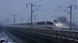 A CRH380BL passes near Jinhuadong Railway Station.JPG