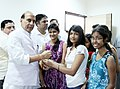 "A Delhi University girl student tying ""Rakhi"" to the Union Home Minister, Shri Rajnath Singh, in New Delhi on August 26, 2015.jpg"