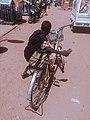A boy getting ready to climb on his bike.jpg