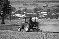 A man is farming with tractor.jpg