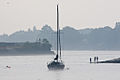 A sailboat on the Piscataqua River awaits the passage of the tall ships.jpg