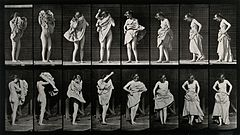 A woman putting a dress on. Photogravure after Eadweard Muyb Wellcome V0048707.jpg