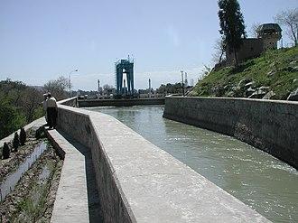 Darunta Dam - Afghan men work by the canal outside the Darunta Hydroelectric Power Plant in 2005
