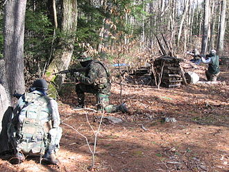 Airsoft - Airsoft players firing at an objective