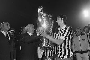 Johan Cruyff receives the cup