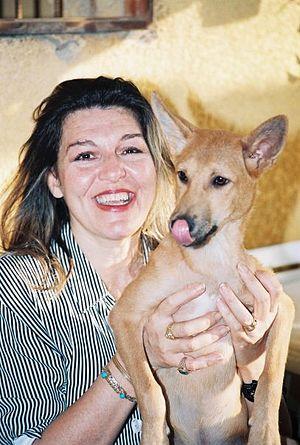 Society for Protection of Animal Rights in Egypt - Amina Tharwat Abaza holding a street dog