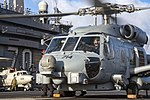 An MH-60R Sea Hawk stops to refuel on the aircraft carrier USS Carl Vinson. (31657065964).jpg