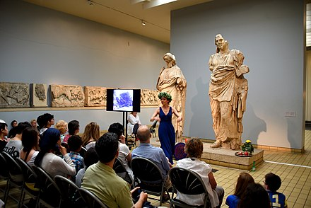An actress performs a play in front of 2 statues from the Mausoleum at Halicarnassus. Room 21, the British Museum, London An actress performs a play in front of 2 statues from the Mausoleum at Halicarnassus. Room 21, the British Museum, London.jpg