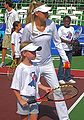 Anna Kournikova at tennis clinic 2010-07 2.jpg