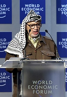 تفصیل= Yasser Arafat speaking at the World Economic Forum in 2001