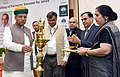 """Arjun Ram Meghwal lighting the lamp to inaugurate the National Seminar on """"Doubling of Farmers' Income by 2022'', organised by the NABARD, on its 35th Foundation Day, in New Delhi.jpg"""
