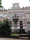 foto van Herenhuis met hek uit 1889 in eclectische neorenaissance