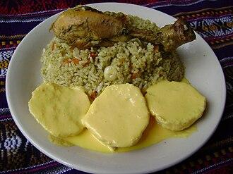 Arroz con pollo - Homemade arroz con pollo and papas a la huancaína (bottom), Lima, Perú