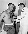 Astronaut Gus Grissom preparing for centrifuge training.jpg