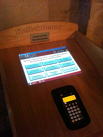 Offertory - Kollektomat (collectomat), an automatic offertory machine with a card reader in Lund Cathedral, Sweden
