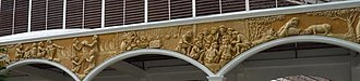 Madja-as -  ''Bas relief'' of the Barter of Panay at the facade of the municipal gymnasium of the town of San Joaquin, Iloilo (Panay), Philippines - the town to where the place of landing of the ten Bornean Datus now belongs.