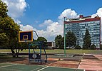 Basketball court and Humanities Tower, Ciudad Universitaria, Mexico City.jpg