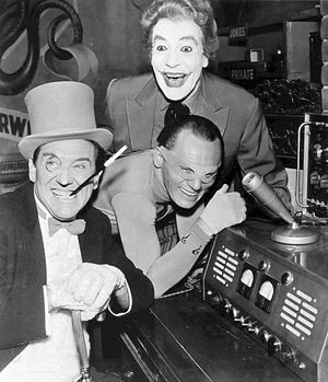 Joker (character) - Cesar Romero as the Joker in the 1960s Batman TV series with Burgess Meredith (left) as the Penguin and Frank Gorshin as the Riddler