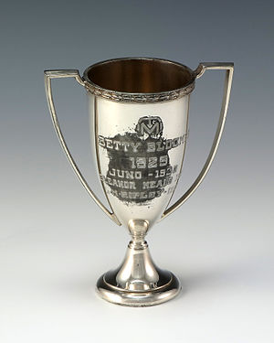 "Central High School (Grand Rapids, Michigan) - Silver, loving cup tennis trophy awarded to Betty Bloomer from Central High School. Engraving reads, ""TM / Betty Bloomer / 1929 / Juno - 1930 / Eleanor Heald - 1931/ L-M-Ripley - 1932."""